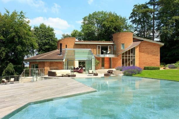 Carol Vorderman's home in Somerset which is up for sale. See SWNS story SWCAROL; TV brainbox Carol Vorderman has put her posh party home on the market for £2.7 million. The former Countdown star, 55, bought the home in 2007 and quickly applied for planning permission to rename it Sloblock - an anagram of B*llocks. She then spent two years carrying out a lavish refurbishment of the home, fitting so much insulation she hardly has to heat it. Sloblock was built in the 1970s and designed on a series of concentric circles, combining modern architecture and minimalist design., Image: 292475509, License: Rights-managed, Restrictions: follow us on twitter - @swns browse our website - swns.com email pix@swns.com, Model Release: no, Credit line: Profimedia, SWNS